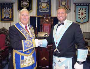 Roger Perry (left) as he congratulates Kirk Elliot.