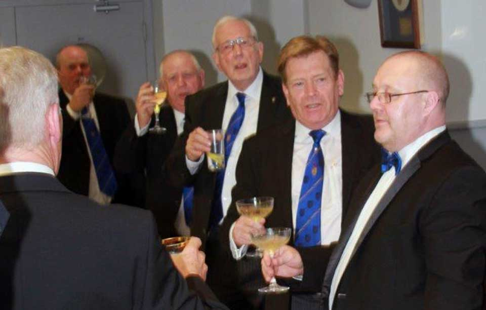 Pictured are the brethren toasting the new master.