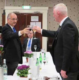 Shaun Haynes (left) toasting the new master David Holloway.