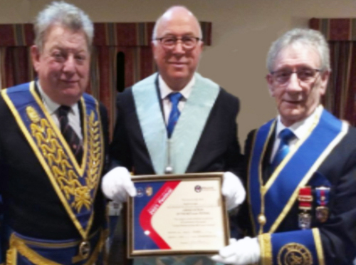 Ian Gee (left) and Eric Ashcroft, with Malcolm Sandywell (right) presenting the lodge's Grand Patron Certificate for the MCF 2021 Festival.
