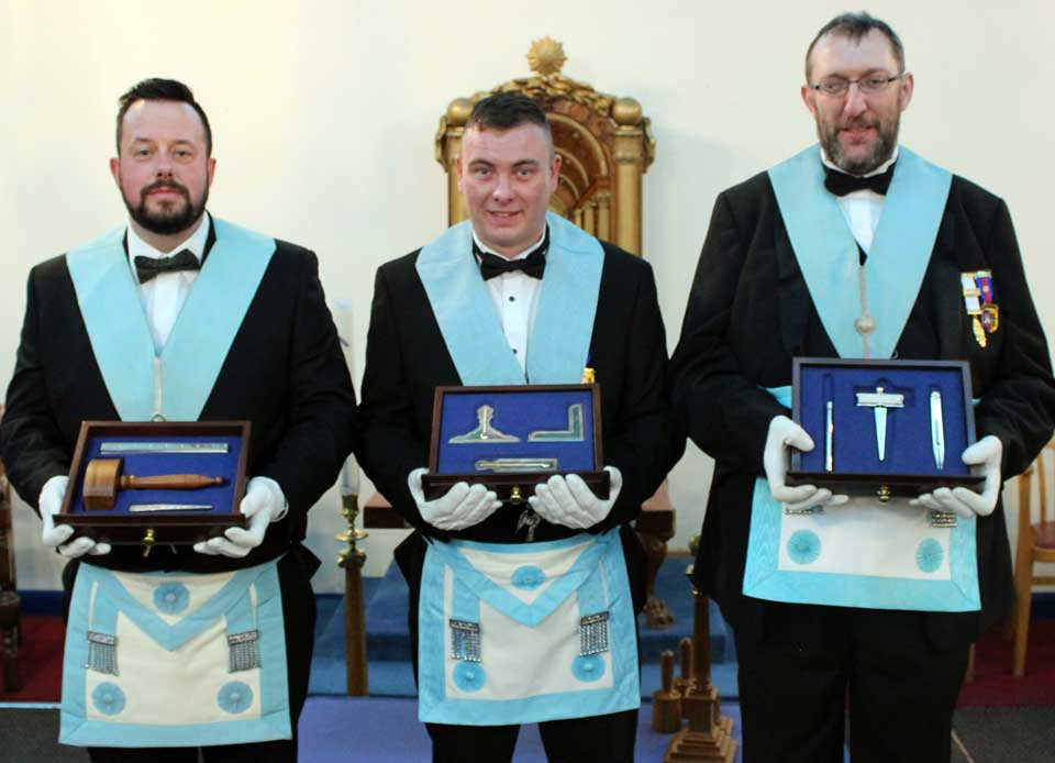 Pictured from left to right, are: the three members who presented the working tools, Wayne McGuffie, Adam Woods and Stuart Flynn.