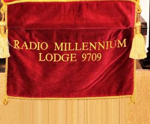 Phillip sees Paul installed at Radio Millennium