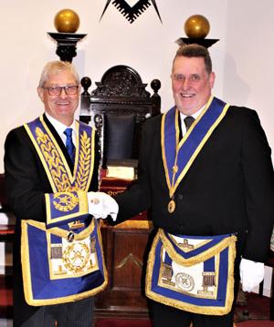 Gareth (left) congratulates Stephen on his installation.