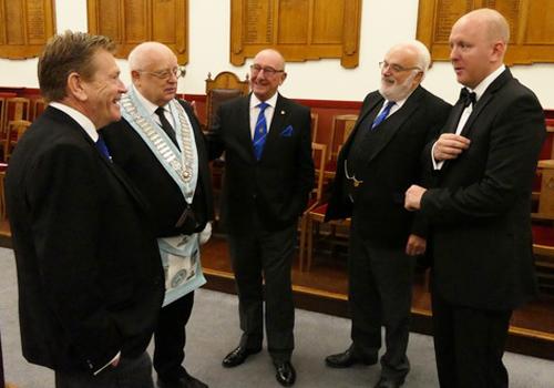 Senior Masons giving David (second left) reassurance before the ceremony.