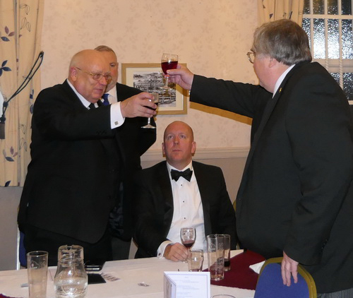 David (left) taking wine with Peter Whalley during the Master's Song.
