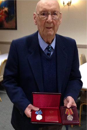 Bert a few years ago with his medals from the Arctic Campaign of WW2.