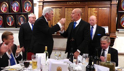 Tony Harrison (left) takes wine with Graham Fairley.