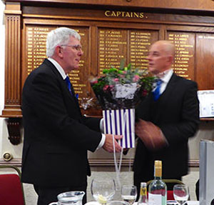 Tony presented with the bouquet of flowers.