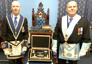 Ian McGovern (left) and Alan Routledge receive the gold-plated working tools