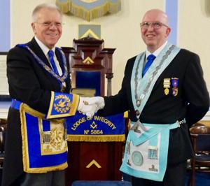 Derek Parkinson (left) congratulates Colin Rogers