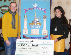 Tony Lowe, the current master, presenting the donation of £500 to the Baby Beat Appeal.