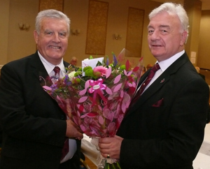 Bryan Hoarty (left) presents flowers to Barrie Crossley