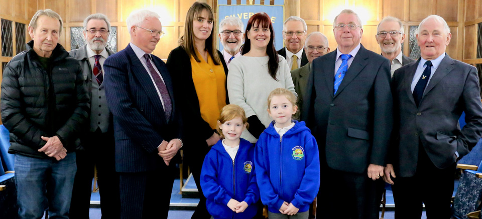 Pictured from left to right, are: Alec Dobson, Kevan Isherwood, Jim Bennetts, Elen Berry (school teacher and staff governor), John Robson, Katie Walsh, Chris Brown, Tony Jackson, Tony Dickinson, Andrew Wood and Peter Mason. Front row - are two of the school pupils.