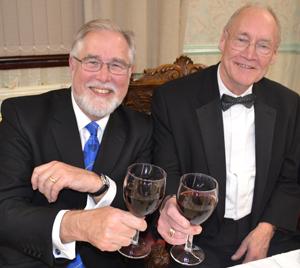 Phil Gardner (left) toasting the health of the new WM John Bates.