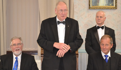 John Bates (centre) responding to his toast in the company of, from left to right: Phil Gardner, Mick Taylor and Anthony Gregg.