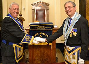 Regional charity representative George Crawley (left) welcomed by WM and installing master Ian Niven.
