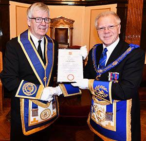 John Mace (left) receives his 50-year certificate from Derek Parkinson.