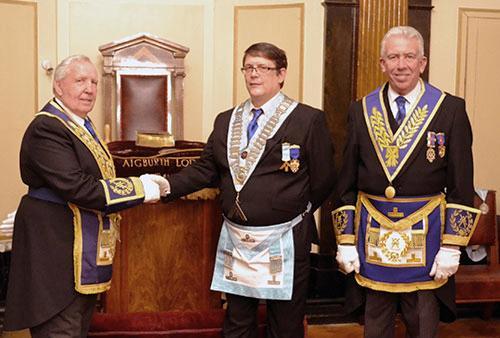Roy Ashley (left) congratulates WM Mark Lawrence with Mark Matthews.