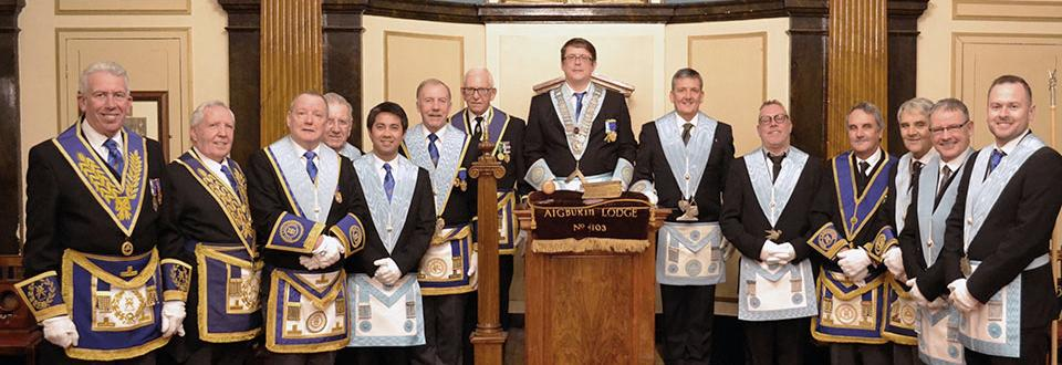 Honoured guests Mark Matthews (left) and Roy Ashley (second left) with newly invested officers of Aigburth Lodge and WM Mark Lawrence (centre).