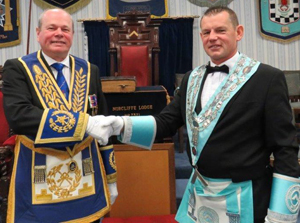 Pictured is Duncan Smith (left) congratulating the new WM Jason Bleakley.