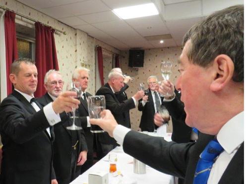 Pictured are the brethren toasting their new WM Jason Bleakley.