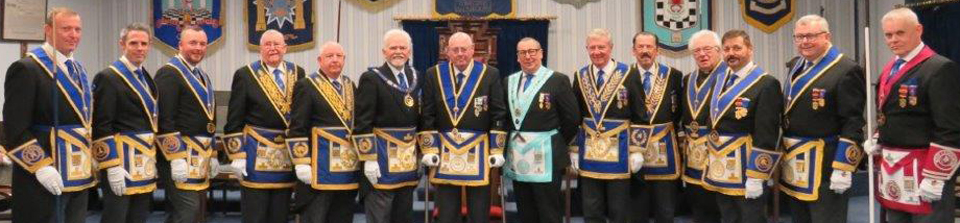 Pictured is David Randerson and Ray Bird (centre) with the line-up of grand and acting officers.