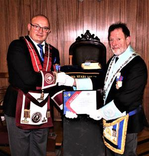 Darren Gregory (left) presents the MCF Vice Patron Certificate to Steve Masters.