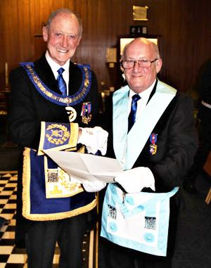 Barry presents Ken Harding with his Grand Lodge Certificate.