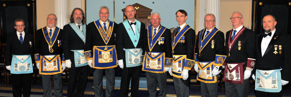 Pictured from fourth left from left to right, are: Andrew Whittle, Andy Steel, Bill Bruce and Graham Williams with Province grand officers and members of St Helens Lodge of Loyalty.