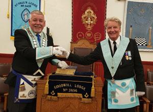 WM of the lodge Bob Williams (left) congratulates Paul Dayus.