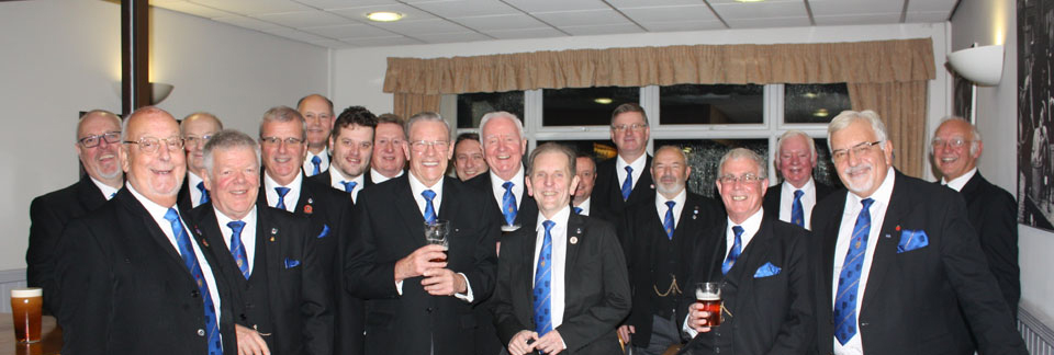The 'Wigan Wanderers' turn out in force to celebrate with Alan.
