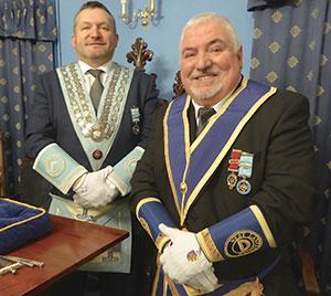 Andrew (left) with proud dad Len.