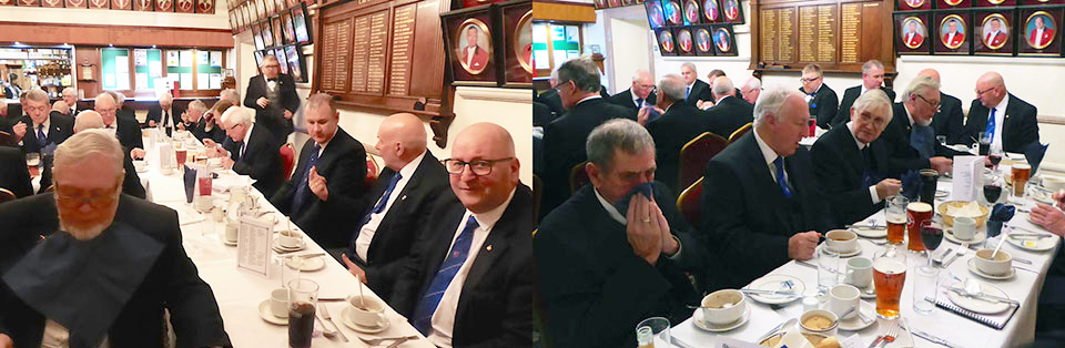 The diners enjoy a hearty festive board.