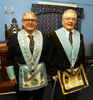 Peter Ryan (left) welcomes master elect Geoffrey Cowan.