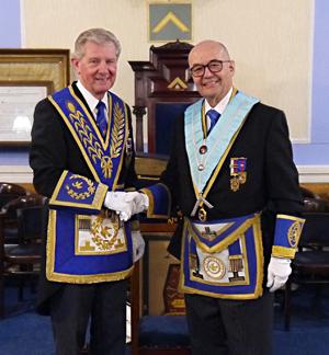 Stuart Thornber (left) congratulates Dr Graham Hoadley.
