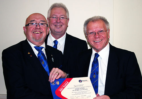 Derek (right) presents Barry with the Grand Patron's Certificate with John Murphy looking on.