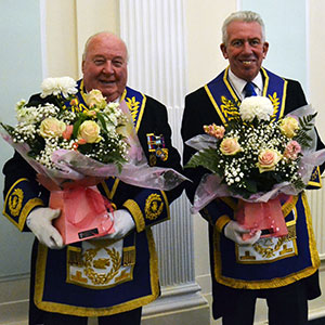 Peter Levick (left) and Mark Matthews with the floral bouquets.