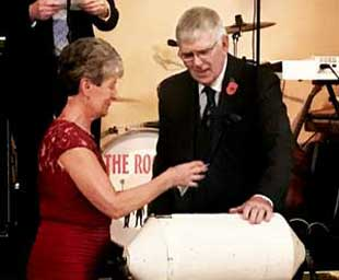 Tony and Maureen draw the raffle at the Charity Stewards Dinner.