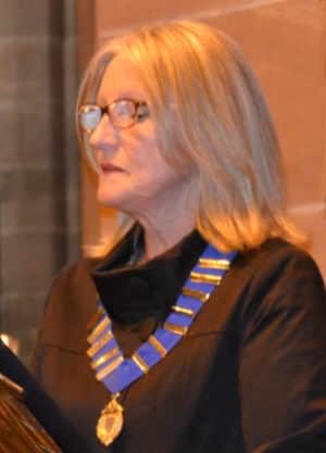 Debbie Matthews reading to the congregation.