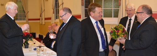 Left picture: Norman Pritchard (left) toasting Graham whilst singing the master's song. Right picture: Kevin (left) being presented with a bouquet by Graham whilst observed by Norman.