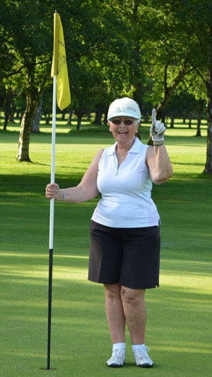 Jean celebrating her 'hole-in-one'.