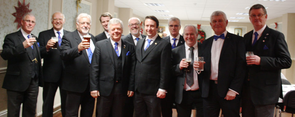 Members of the 'Wigan Wanderers' enjoy a drink before the festive board.
