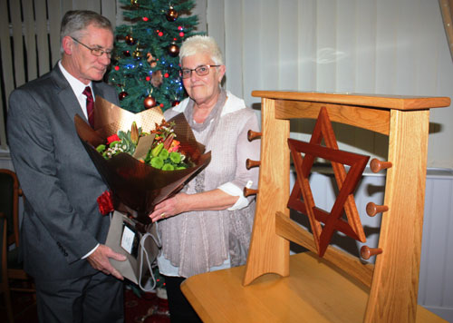 Bill Peterson presents flowers to Evelyn Sheppard.