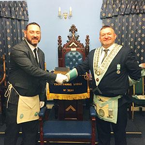 Andrew Jones (right) congratulates Andrew Aitchison.