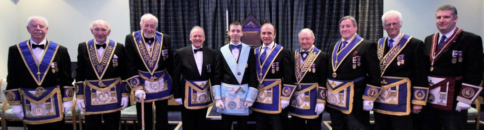 A 'mustering' of grand and group officers, with newly installed master Michael Threlfall centre stage.