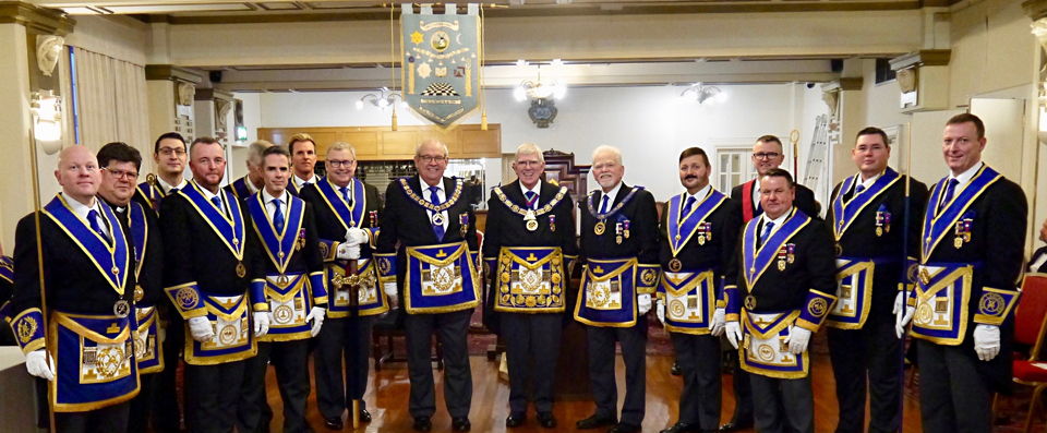 Tony Harrison (centre), Philip Gunning (centre left), David Randerson (centre right) with the Provincial team at the centenary meeting.