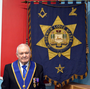 Bob Baxendale next to the 100 year old Horwich Lodge Banner.