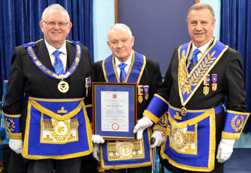 Bob Baxendale being presented with his 50 years certificate by Stewart Seddon (left) and Peter Lockett