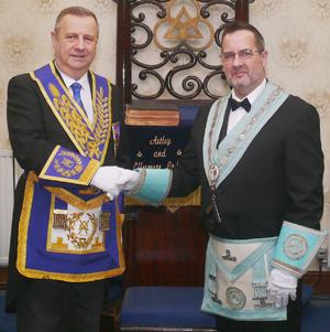 Peter Lockett (left) congratulates the new master Mark Briggs
