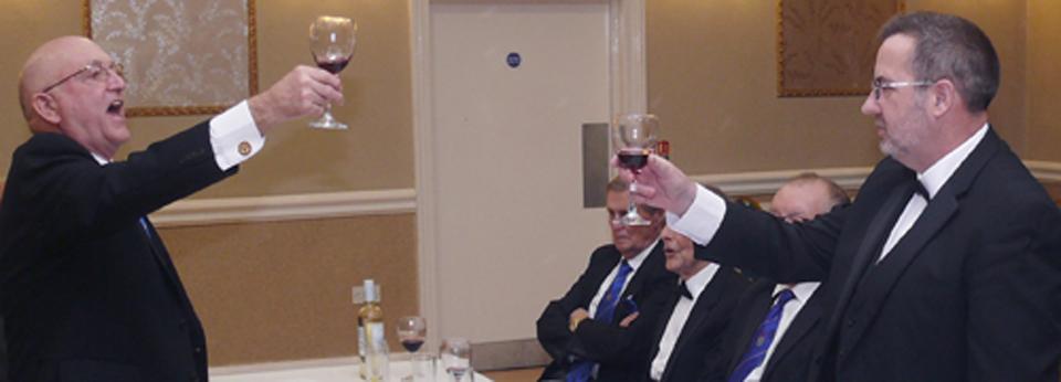 Brian Flynn (left) toasts Mark Briggs in song